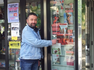 Milko outside his Cartolibireria showing my books for sale! Photo J Finnigan