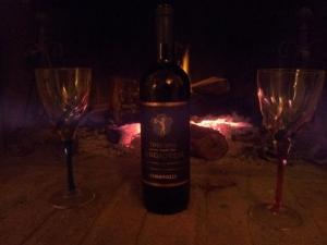 Warming a nice bottle of local wine. Photo J Finnigan