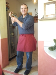 Paolo who made the Rose Sauce, shaking a bottle of frozen crema di limoncello.  Photo J Finnigan