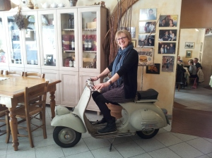 The Sister posing on vintage Vespa at Osteria la Gramola Photo J Finnigan