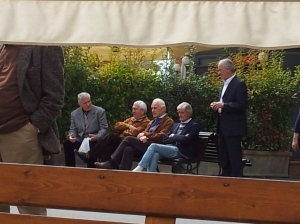 A flock of common Italian men, one with olive branch. Photo J Finnigan