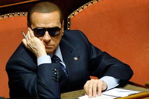 Silvio looking very Mafiosi. Photo Reuters