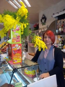 Lovely laura with her gift of Mimosa from our garden.  A little thank you to a hard working lady. Photo J Finnigan.