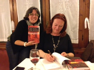 Me signing Valerie's books Photo Jackie