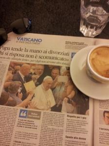 Pope Francis greets the faithful. La Nazione newspaper