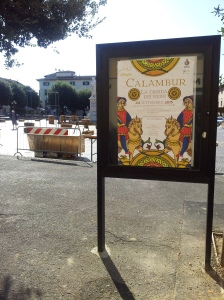 A Calambur poster and preparations going on behind in the main Piazza in Certaldo. Photo J Finnigan