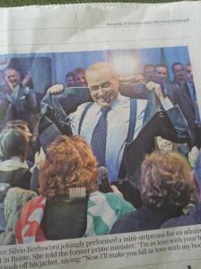 Silvio does a mini-striptease for an admirer in Rome. Daily Telegraph.