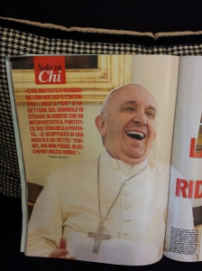 A laughing Pope Francis Magazine in Hairdressers