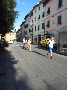 Runners outside Bar Solferino in Certaldo. Phot J Finnigan