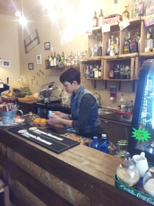 Evi behind the bar at Bar 'Garibaldi 11 Speakeasy' in Certaldo. Foto J Finnigan