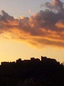 The ancient hill town of Certaldo Alto, silhoueted against the sunset. Photo J Finnigan