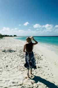 photo of woman on seashore